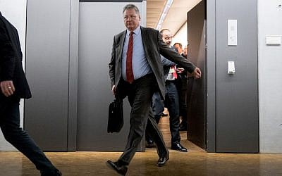 President of the German Federal Intelligence Agency (BND) Bruno Kahl (L) leaves after a meeting with members of the Parliamentary Control Panel (PKGr) at the parliament in Berlin after Russian hackers infiltrated Germany's foreign and interior ministries' online networks, March 1, 2018. (AFP PHOTO / DPA / Kay Nietfeld / Germany OUT)