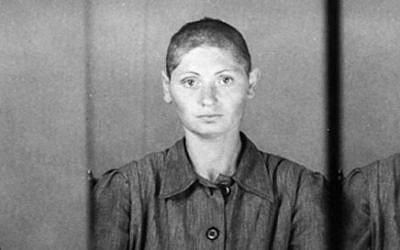Jewish prisoner no. 13088, after her hair is shorn in Auschwitz. (Yad Vashem)