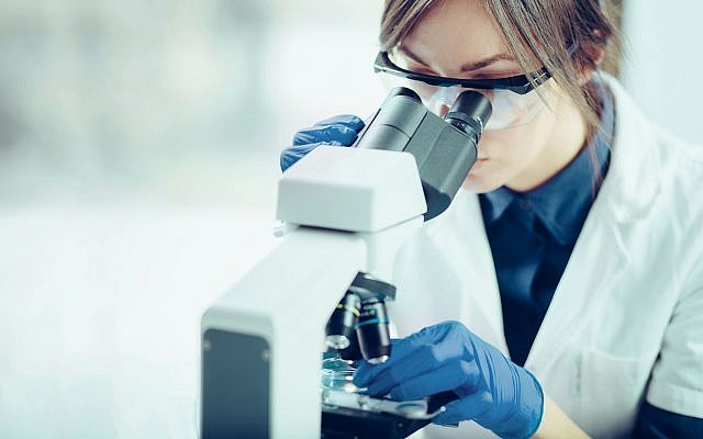 Illustrative image of a scientist in a lab (Likoper, iStock by Getty Images)