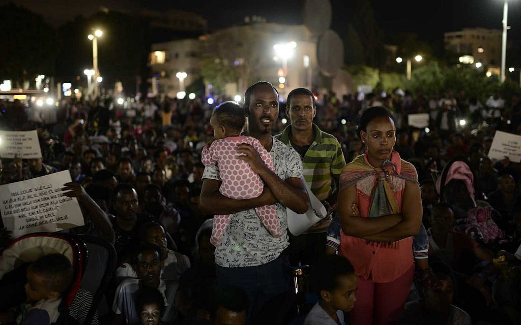 "African migrants take part at a protest against the ""Deposit Law"" in Tel Aviv on June 10, 2017. African asylum seekers protest on Saturday against the ""Deposit Law"", following which Eritreans and Sudanese are required to deposit fifth percent of their salary. Photo by Tomer Neuberg/Flash90"