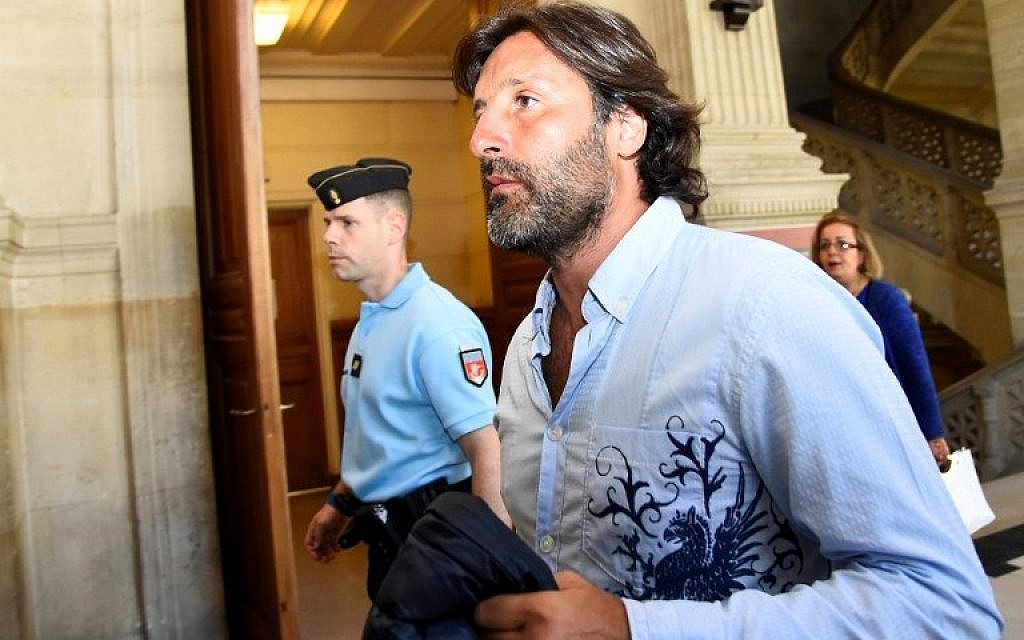 In this file photo taken on July 7, 2016, Arnaud Mimran arrives at the Paris courthouse for deliberations in  his trial over an alleged carbon tax scam.(AFP PHOTO / BERTRAND GUAY)