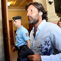Arnaud Mimran arrives at the Paris courthouse for deliberations in his trial over an alleged carbon tax scam, on July 7, 2016. (AFP PHOTO / BERTRAND GUAY)