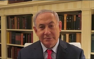 Prime Minister Benjamin Netanyahu attacks the police over the use of state's witnesses in a video clip filmed from the US, March 7, 2018. (Screenshot)