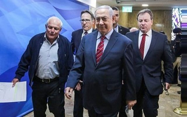 Prime Minister Benjamin Netanyahu arrives at the weekly cabinet meeting at the PM's office in Jerusalem, on March 25, 2018. (Marc Israel Sellem/POOL)