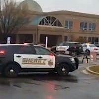 A police car parks outside of Great Mills High School in Maryland where a shooting was reported on March 20, 2018. (Screen capture/Twitter)
