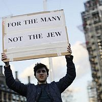 Illustrative: Protests regarding Britain's opposition Labour party leader Jeremy Corbyn and anti-Semitism in the Labour party, outside the British Houses of Parliament in central London on March 26, 2018. (AFP PHOTO / Tolga AKMEN)