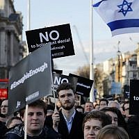 Members of the Jewish community hold a protest against Britain's opposition Labour party leader Jeremy Corbyn and anti-Semitism in the Labour party, outside the British Houses of Parliament in central London on March 26, 2018. (AFP Photo/Tolga Akmen)