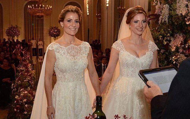 Priscila Raab, left, and Roberta Gradel at their wedding in Rio de Janeiro, March 10, 2018. (Marco Rodrigues)
