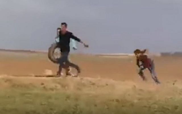 A Palestinian video shows the alleged shooting of a protester with his back to the border, March 31, 2018 (screenshot)