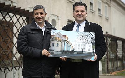 Raed Saleh, left, a Berlin senator, and the city's Jewish community president, Gideon Joffe, hold an architect's rendering of a planned reconstruction of the Fraenkelufer Synagogue. (Sean Gallup/Getty Images)