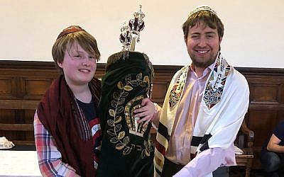 Esther Thorpe, left, who identifies as non-binary, had a gender-neutral b'nei mitzvah ceremony with the help of student rabbi Gabriel Webber. (Courtesy of Miriam Taylor Thorpe)