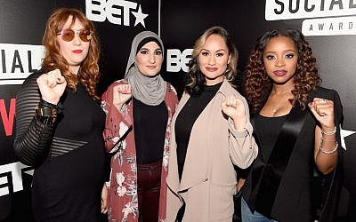 The organizers of the Women's March, from left to right: Bob Bland, Linda Sarsour, Carmen Perez, and Tamika Mallory, at BET's Social Awards in Atlanta, February 11, 2018. (Paras Griffin/Getty Images for BET via JTA)
