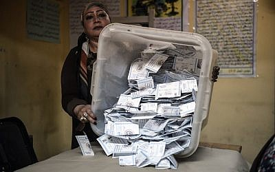 Electoral workers sort ballots to be counted at the end of the final day of the Egyptian presidential election in Cairo, Egypt, 28 March 2018. (Mohamed el-Shahed/AFP)