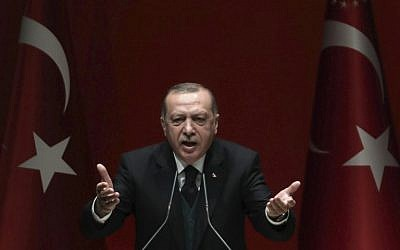Turkish President Recep Tayyip Erdogan makes a speech during Turkey's ruling Justice and Development (AK) Party's provincial chairmen meeting at the party headquarters in Ankara on March 30, 2018.  (ADEM ALTAN/AFP)
