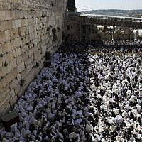 Jews wearing prayer shawls take part in the Kohanim prayer (priest's blessing) during the Passover holiday at the Western Wall in the Old City of Jerusalem, on April 2, 2018. ( AFP PHOTO / MENAHEM KAHANA