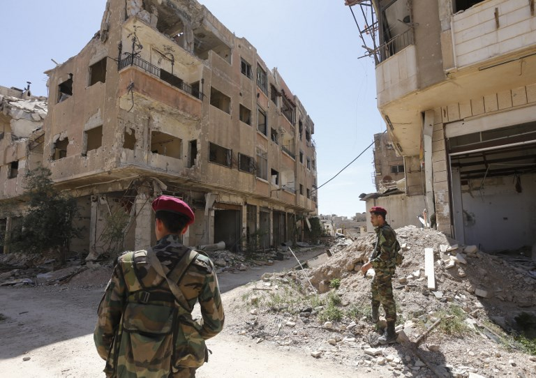 Small number of rebels start to leave Syria's Douma