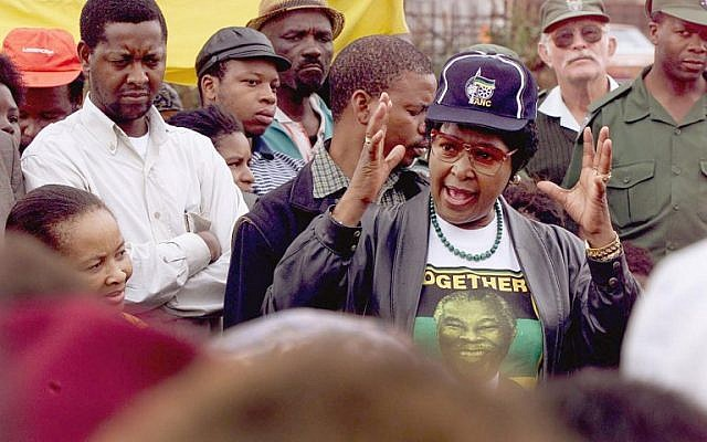 In this file photo taken on April 21, 1999 Winnie Mandela addresses a crowd, in the Mnandi squattercamp some 20 km west of Pretoria. (AFP PHOTO / Odd ANDERSEN)