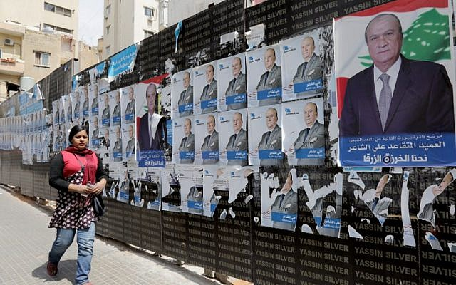 A picture taken on April 3, 2018 shows campaign posters, for the upcoming Lebanese parliamentary election, hanging in the Tariq Jedideh district of Beirut. (AFP Photo/Anwar Amro)