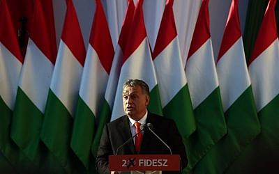 Hungarian Prime Minister Viktor Orban delivers his speech during the last campaign event of his Fidesz party in Szekesfehervar, Hungary on April 6, 2018.  Hungarians vote in elections on April 8, 2108 that polls suggest will give Prime Minister Viktor Orban athird consecutive term. ( AFP PHOTO / FERENC ISZA)