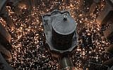 """Christian Orthodox worshippers hold up candles during the ceremony of the """"Holy Fire"""" as they gather in the Church of the Holy Sepulchre in Jerusalem's Old City, on April 7, 2018, during Orthodox Easter ceremonies.(AFP PHOTO / MENAHEM KAHANA)"""
