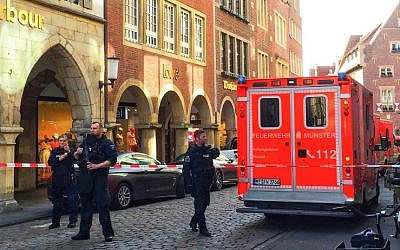 Police and first responders work at the scene where several people were killed and injured when a car plowed into pedestrians in Munster, western Germany on April 7, 2018. (AFP PHOTO / dpa)