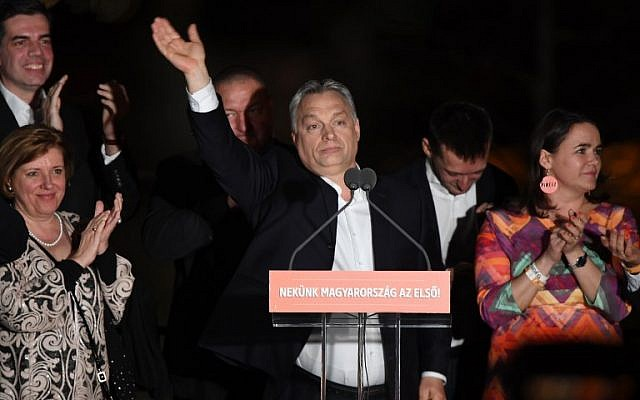 Hungarian Prime Minister Viktor Orban and members of his FIDESZ party celebrate from the podium on the bank of the Danube River after winning the parliamentary election on April 8, 2018 in Budapest. (AFP PHOTO/ATTILA KISBENEDEK)