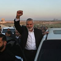 "Hamas leader Ismail Haniyeh gestures as he makes a stop on April 9, 2018, at the site of violent ""March of Return"" protests on the Israel-Gaza border east of Gaza City.  (AFP Photo/Mahmud Hams)"
