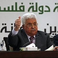 Palestinian Authority President Mahmoud Abbas gestures as he speaks during a press conference on Jerusalem, in the West Bank city of Ramallah on April 11, 2018. (AFP/Abbas Momani)