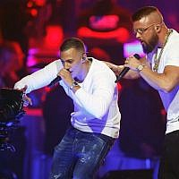 German rappers Kollegah & Farid Bang perform during the 2018 Echo Music Awards ceremony on April 12, 2018 in Berlin (AFP PHOTO / AXEL SCHMIDT)