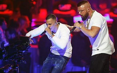 German rappers Kollegah & Farid Bang perform during the 2018 Echo Music Awards ceremony on April 12, 2018, in Berlin (AFP PHOTO / AXEL SCHMIDT)