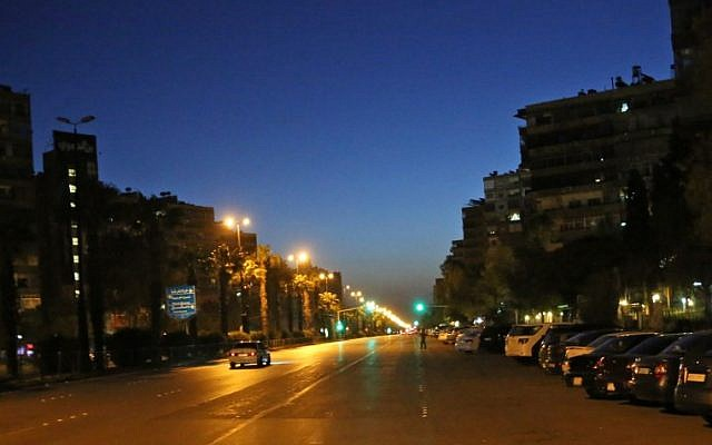 A photo taken in the early hours of April 14, 2018 shows slow traffic on a main avenue in Damascus's Mazze neighborhood after the US, France, and Britain launched a joint operation against the Syrian government. (AFP PHOTO / STRINGER)