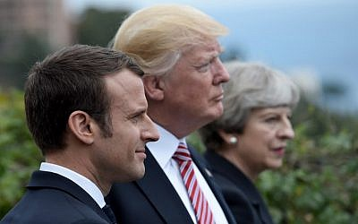 This file photo taken on May 26, 2017 shows (L-R) French President Emmanuel Macron, US President Donald Trump and Britain's Prime Minister Theresa May attending the Summit of the Heads of State and of Government of the G7 plus the European Union in Taormina, Sicily. (AFP PHOTO / STEPHANE DE SAKUTIN)