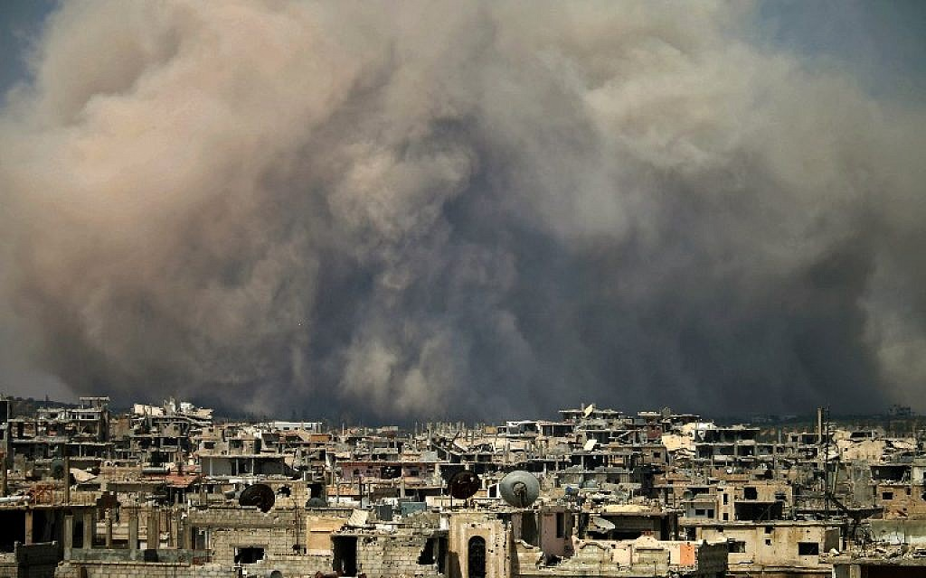 Illustrative: Billowing smoke, following a reported air strike on a rebel-held area in the southern Syrian city of Daraa. (Mohamad Abazeed/ AFP)