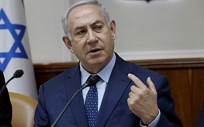 Israeli Prime Minister Benjamin Netanyahu gestures at the start of the weekly cabinet meeting at the Prime Minister's office in Jerusalem April 15, 2018. (AFP/Gali Tibbon)