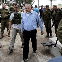 Defense Minister Avigdor Lieberman (C) leaves after a press conference in the southern kibbutz of Nahal Oz on April 20, 2018, near the Israeli border with the Gaza Strip, following his visit to Israeli troops positioned along the border with the coastal enclave during Friday clashes. (AFP Photo/Thomas Coex)