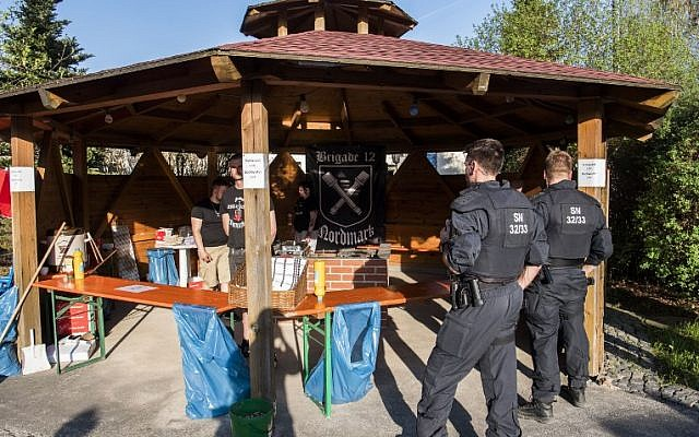 Police officers inspect the premises at the 'Schild und Schwert' (Shield and Sword) neo-Nazi festival, in the small eastern German town of Ostritz on April 20, 2018. (AFP PHOTO / John MACDOUGALL)