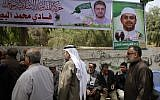 Palestinians gather in mourning outside the family home of 35-year-old professor and Hamas member Fadi Mohammad al-Batsh, who was killed early in the day in Malaysia, in Jabalia in the northern Gaza strip on April 21, 2018. (AFP PHOTO / MAHMUD HAMS)