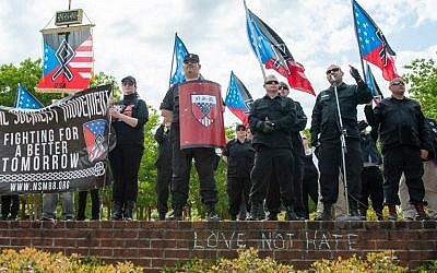 National Socialist Movement leader Jeff Schoep (2nd R) speaks during a white nationalist rally in Newnan, Georgia on April 21, 2018.  (AFP PHOTO / BITA HONARVAR)