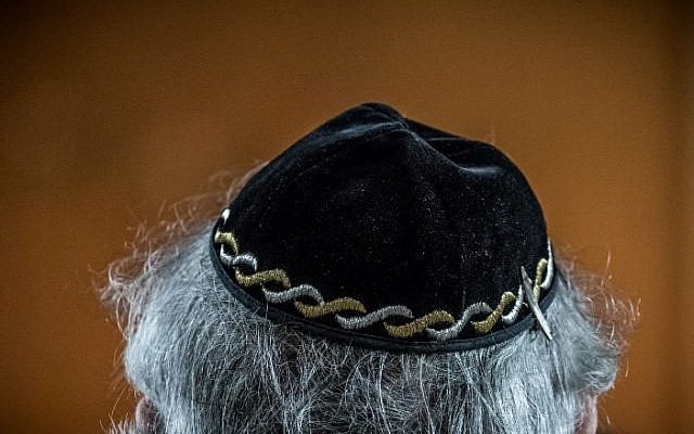 "A Jewish man wears a kippa, or Jewish religious skull cap, during a meeting on ""the German and French perspectives on immigration, integration and identity"" organised by the American Jewish Committee (AJC) on April 24, 2018 in Berlin. ( AFP PHOTO / dpa / Michael Kappeler )"