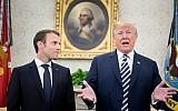 French President Emmanuel Macron (L) listens as US President Donald Trump seeks to the press in the Oval Office before a meeting during a state visit to the White House April 24, 2018 in Washington, DC. (AFP PHOTO / Brendan Smialowski)