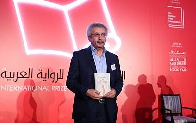 "Palestinian writer Ibrahim Nasrallah poses for a photo after winning the 2018 International Prize for Arabic Fiction for his book titled ""The Second war of the Dog"" in Abu Dhabi on April 24, 2018 (Karim Sahib/AFP Photo)"