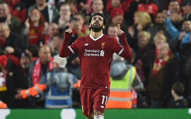 8cf6161da Liverpool s Egyptian midfielder Mohamed Salah celebrates scoring their  first goal during the UEFA Champions League first
