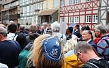 """A participant of the """"Thuringia wears kippa"""" rally wears a kippa in Erfurt, central Germany, on April 25, 2018. (AFP PHOTO / dpa / Bodo Schackow)"""