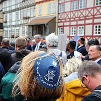 "A participant of the ""Thuringia wears kippa"" rally wears a kippa in Erfurt, central Germany, on April 25, 2018. (AFP PHOTO / dpa / Bodo Schackow)"