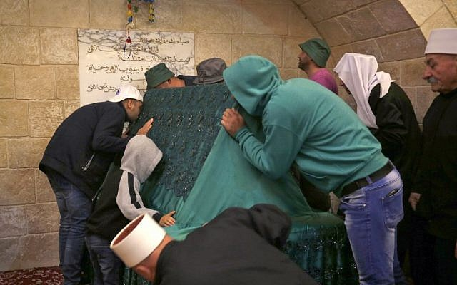 Members of Israel's Druze community kiss the holy tomb of Nebi Shu'eib during a celebration in northern Israel on April 25, 2018. (AFP Photo Jalaa/Marey)