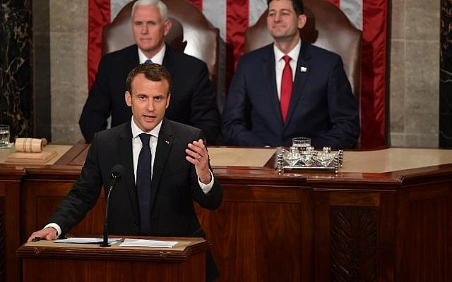 House Speaker Paul Ryan, right, and US Vice President Mike Pence, back left, listen as France's President Emmanuel Macron addresses a joint meeting of Congress inside the House chamber on April 25, 2018 at the US Capitol in Washington, DC. (AFP Photo/Mandel Ngan)