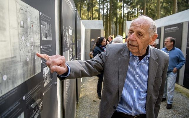 Henrik Mordechai Gideon, Holocaust survivor and former prisoner at the former Muehldorfer Hart concentration camp, gives explanations on a site map prior to the inauguration of the Muehldorfer Hart camp memorial site near Waldkraiburg, southern Germany, on April 27, 2018. (AFP/dpa/Matthias Balk)