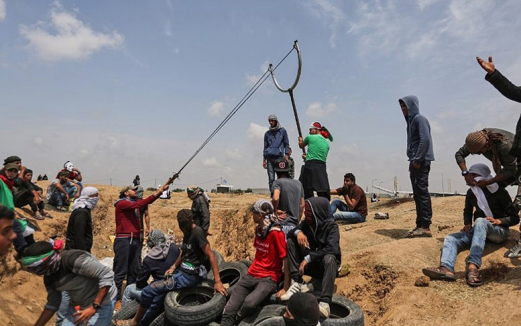 Palestinians Killed, Hundreds Wounded As Protesters Storm Gaza Fence