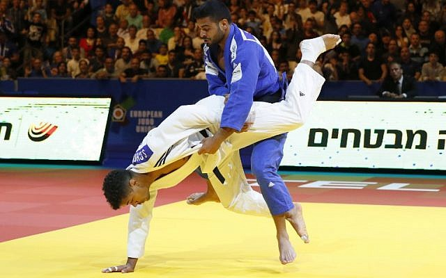Belgium's Sami Chouchi (white) and Israel's Sagi Muki compete in the men's under 81 kg weight category during the European Judo Championship in the Israeli coastal city of Tel Aviv on April 27, 2018. (AFP PHOTO / JACK GUEZ)
