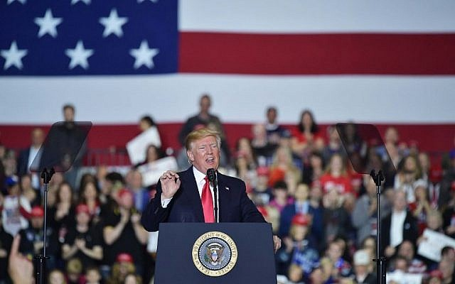 US President Donald Trump speaks during a rally at Total Sports Park in Washington, Michigan on April 28, 2018. (AFP Photo/Mandel Ngan)